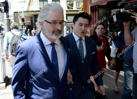 John Jarratt (L), Australian television film actor, producer and director, leaves the Downing Centre District Court in Sydney, Australia, 07 December 2018. The Wolf Creek star will face trial in the New South Wales District Court after he formally pleaded not guilty to a historical rape allegation.
