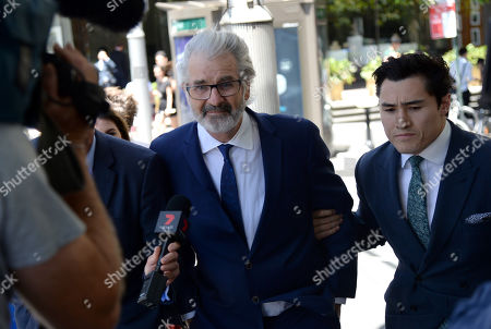 John Jarratt (C), Australian television film actor, producer and director, leaves the Downing Centre District Court in Sydney, Australia, 07 December 2018. The Wolf Creek star will face trial in the New South Wales District Court after he formally pleaded not guilty to a historical rape allegation.