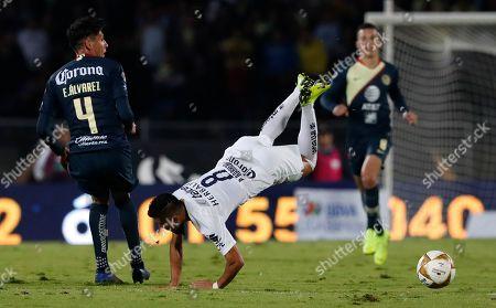 Pumas' Pablo Barrera, center, fails to pass America's Edson Alvarez, left, during a Mexico soccer league first leg semifinals match in Mexico City