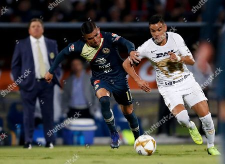 America's Luis Reyes, left, and Pumas' Pablo Barrera compete for the ball during a Mexico soccer league first leg semifinals match in Mexico City