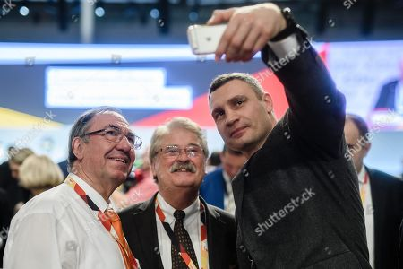 The Mayor of Kiev Vitali Klitschko (R) and Member of Parliament Elmar Brok (C) take a selfie during the 31st Party Congress of the Christian Democratic Union (CDU) in Hamburg, Germany, 07 December 2018. At the party congress, a new party leader is to be elected. Associated with the new party leader is the debate over the fundamental political orientation of the CDU after Chancellor Merkel will no longer hold this office.