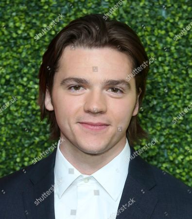 Joel Courtney arrives at the 2018 GQ's Men of the Year Celebration, in Beverly Hills, Calif
