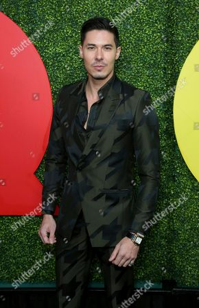 Lewis Tan arrives at the 2018 GQ's Men of the Year Celebration, in Beverly Hills, Calif