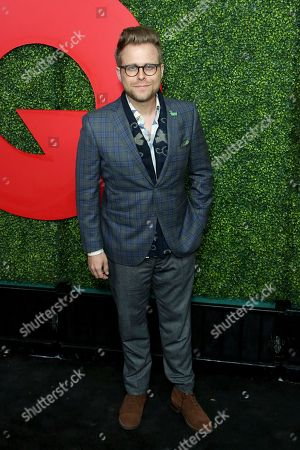 Adam Conover arrives at the 2018 GQ's Men of the Year Celebration, in Beverly Hills, Calif