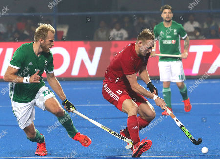 England?s David Ames (R) in action against Conor Harte of Ireland during the men's Field Hockey World Cup match between Ireland and England at the Kalinga Stadium in Bhubaneswar, India, 07 December 2018.