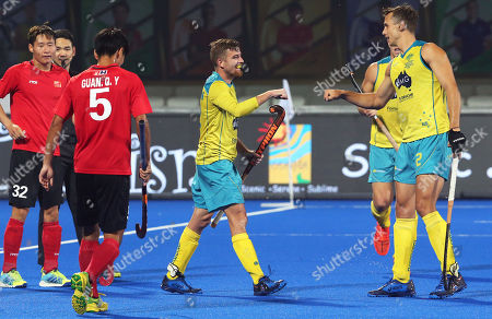 Australia's Jake Whetton (C) celebrates with his teammate Tom Craig (R) after scoring the 6-0 lead during the men's Field Hockey World Cup match between Australia and China at the Kalinga Stadium in Bhubaneswar, India, 07 December 2018.