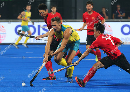 Australia's Tom Craig (C) in action against Ao Suozhu (R) of China during the men's Field Hockey World Cup match between Australia and China at the Kalinga Stadium in Bhubaneswar, India, 07 December 2018.