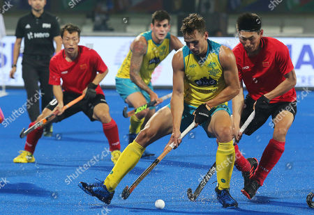 Australia's Tom Craig (C) in action against Meng Dihao (R) of China during the men's Field Hockey World Cup match between Australia and China at the Kalinga Stadium in Bhubaneswar, India, 07 December 2018.