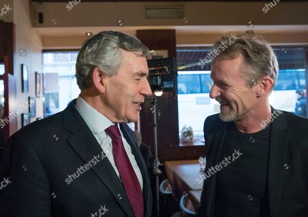 Former British Prime Minister Gordon Brown (L) talks with Norwegian author Jo Nesbo during the presentation of the Harry Hole Prize to Brown to promote basic literacy skills in developing countries, in Oslo, Norway, 07 December 2018. The prize is named after the literary figure Harry Hole in Jo Nesbo's books.