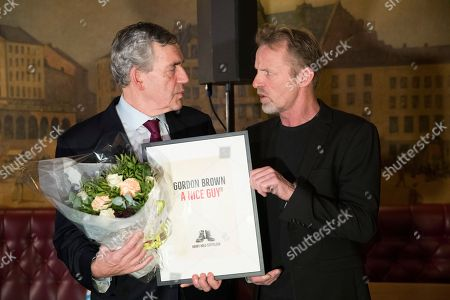 Former British Prime Minister Gordon Brown (L) receives the Harry Hole Prize called 'A Nice Guy' Norwegian author Jo Nesbo to promote basic literacy skills in developing countries, in Oslo, Norway, 07 December 2018. The prize is named after the literary figure Harry Hole in Jo Nesbo's books.