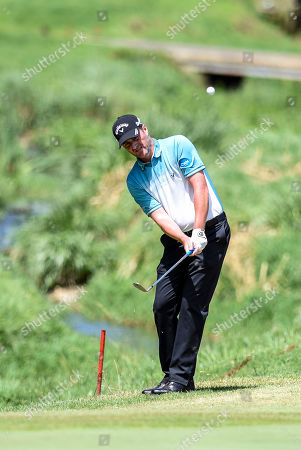 Marc Warren of Scotland plays a shot during the South African Open Golf Championship at the Randpark Golf Club in Johannesburg, South Africa, 07 December 2018.