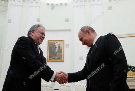 Russian President Vladimir Putin (R), shakes hands with Greek Alternate Foreign Minister Georgios Katrougalos (L), during their meeting in the Kremlin in  Moscow, Russia, 07 December 2018.