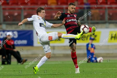 Stock Photo of Western Sydney Wanderers defender Josh Risdon (4) and Central Coast Mariners midfielder Michael McGlinchey (8) battle for the ball