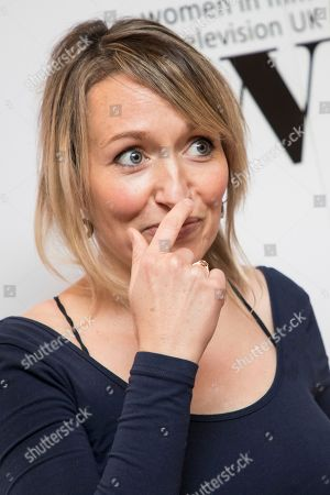Kate Quilton poses for photographers upon arrival at the Women in Film and TV Awards, in London