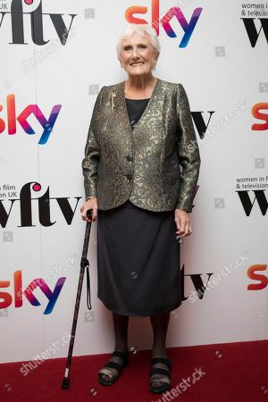 Beryl Vertue poses for photographers upon arrival at the Women in Film and TV Awards, in London
