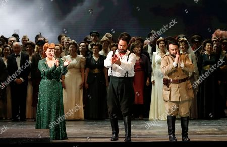 """Russian bass Ildar Abdrazakov, center, Spanish soprano Saioa Hernandez, left, and Romanian baritone George Petean acknowledge the applause of the audience at the end of Giuseppe Verdi's opera, Attila, at La Scala opera house in Milan, Italy, . La Scala's season premiere of a new production of Verdi's """"Attila"""" takes on contemporary themes of male leaders selling out to self-interest while the final act of heroism falls to a woman. The gala event every Dec. 7 is one of the highlights of the European cultural calendar"""