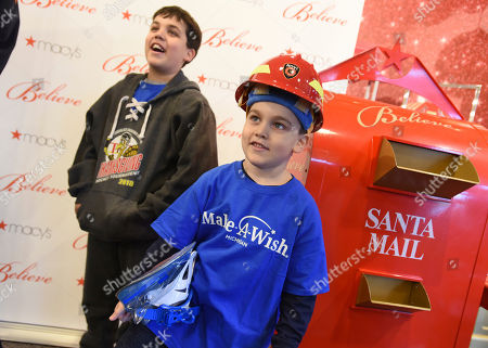Macy's celebrates National Believe Day by helping Make-A-Wish grant 25 Wishes Across America, including Mason, age 6, whose wish to go on a snowboarding trip with his family, was revealed at Macy's Twelve Oaks, in Novi, Mich. Mason smiled with his brother, Darren, age 10