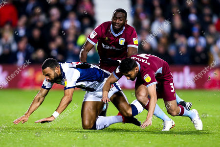 Matt Phillips of West Bromwich Albion collides with Neil Taylor and Yannick Bolasie of Aston Villa