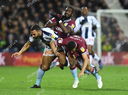 Matt Phillips of West Bromwich Albion collides with Yannick Bolasie and Neil Taylor of Aston Villa