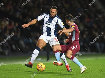 Matt Phillips of West Bromwich Albion and Neil Taylor of Aston Villa