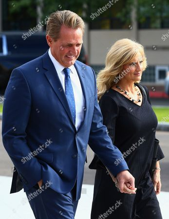 Republican Arizona Sen. Jeff Flake, left, and his wife Cheryl, right, arrive for the funeral of former Democratic U.S. Rep. Ed Pastor, in Phoenix. Pastor was Arizona's first Hispanic member of Congress, spending 23 years in Congress before retiring in 2014. Pastor passed away last week at the age of 75