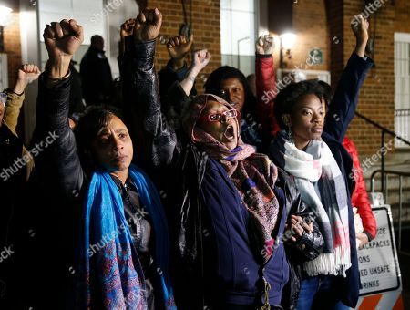 Local activists raise their fists after the guilty verdict in the trial of James Alex Fields Jr., outside Charlottesville General District Court in Charlottesville, Va., . Fields was convicted of first degree murder in the death of Heather Heyer as well as nine other counts related to his ramming his car into a crowd after a white nationalist rally in 2017