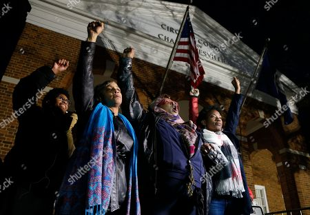 "Local activists raise their fists outside Charlottesville General District Court after a guilty verdict was reached in the trial of James Alex Fields Jr., in Charlottesville, Va., . Fields was convicted of first degree murder in the death of Heather Heyer as well as nine other counts during a ""Unite the Right"" rally in Charlottesville"
