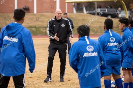 Stock Picture of Ahead of the MLS Cup, MLS coach Brad Friedel leads students from Jean Childs Young Middle School in drills during a clinic hosted by Allstate on Friday, December 7, 2018 in Atlanta. Allstate, a longtime supporter of the soccer community, is the Official Insurance Partner of Major League Soccer (MLS