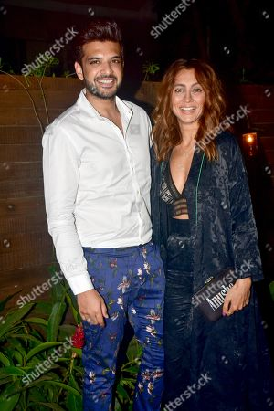 Stock Image of Indian actor and actress Karan Kundra, L, with VJ Anusha Dandekar, R, seen posing for a picture at Bumble's India launch party at Soho House, Juhu In Mumbai.