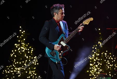 """M. Ward of the music duo She & Him performs amongst onstage Christmas trees during the """"A Very She & Him Christmas Party"""" at the Wiltern Theatre, in Los Angeles"""