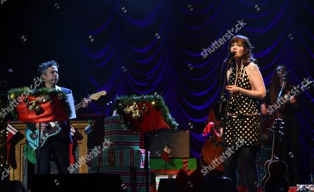 """Stock Photo of M. Ward, Zooey Deschanel. M. Ward, left, and Zooey Deschanel of She & Him perform at the """"A Very She & Him Christmas Party"""" at the Wiltern Theatre, in Los Angeles"""