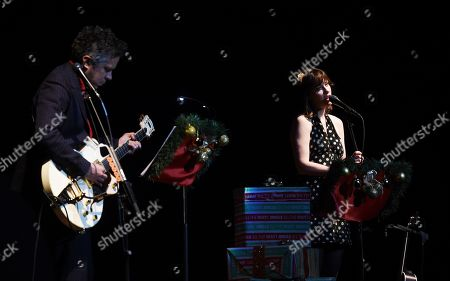 """Stock Image of M. Ward, Zooey Deschanel. M. Ward, left, and Zooey Deschanel of She & Him perform at the """"A Very She & Him Christmas Party"""" at the Wiltern Theatre, in Los Angeles"""