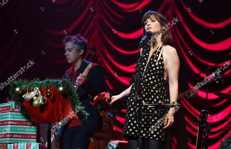 """Zooey Deschanel, M. Ward. Zooey Deschanel, right, and M. Ward of She & Him perform at the """"A Very She & Him Christmas Party"""" at the Wiltern Theatre, in Los Angeles"""