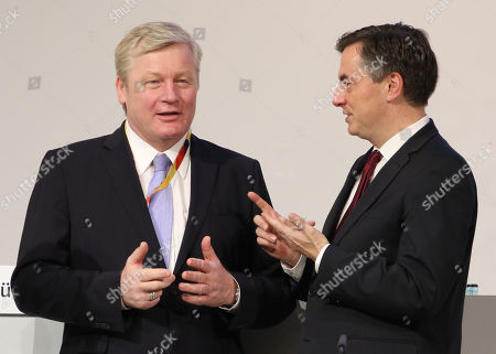 Deputy party chairman Bernd Althusmann (L) and the vice president of the European People's Party, David McAllister (R), chat during the 31st Party Congress of the Christian Democratic Union (CDU) in Hamburg, Germany, 08 December 2018.