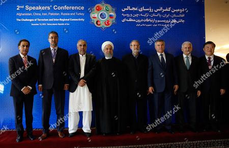 Iranian President Hassan Rouhani (C), Afghan Parliament Speaker Abdul Rauf Ibrahimi (L-2), Pakistan Parliament speaker Asad Qaiser (L-3), China Parliament speakers, Chen Zhu (R), Turkish Parliament Speaker Binali Yildirim (R-2), Russia Parliament speakers Vyacheslav VolodinÊ(R-3), and Iranian parliament speaker Ali Larijani (R-4), pose for a group photo during the Second Conference of the Parliament Speakers in Tehran, Iran, 08 December 2018. According to media reports, Iranian President Rouhani said that the US withdrawal from the nuclear deal and imposing 'illegal sanctions against Iran' is a clear instance of 'economic terrorism.' The Second Conference of the Parliament Speakers, between Iran, Afghanistan, China, Pakistan, Russia and Turkey, aims at fighting terrorism and strengthening cooperation in the country's regions.