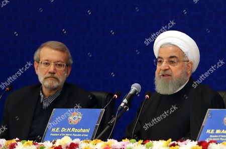 Iranian President Hassan Rouhani (R) speaks as Iranian parliament speaker Ali Larijani (L) looks on during the Second Conference of the Parliament Speakers in Tehran, Iran, 08 December 2018. According to media reports, Iranian President Rouhani said that the US withdrawal from the nuclear deal and imposing 'illegal sanctions against Iran' is a clear instance of 'economic terrorism.' The Second Conference of the Parliament Speakers, between Iran, Afghanistan, China, Pakistan, Russia and Turkey, aims at fighting terrorism and strengthening cooperation in the country's regions.