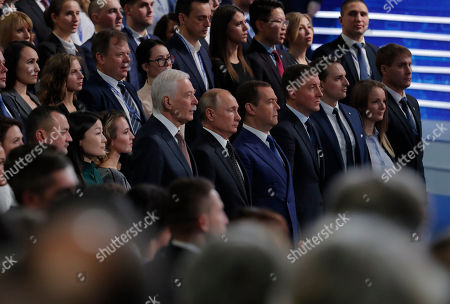 Stock Image of The leader of the United Russia party Boris Gryzlov (6th-L), Russian President Vladimir Putin (C) and Russian Prime Minister Dmitry Medvedev (5th-R) attend the United Russia Party Congress in Moscow, Russia, 08 December 2018. The pro-Kremlin party United Russia is the country's main ruling political party.