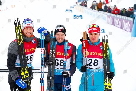 Norway's Sjur Roethe (C) smiles after winning the men's 30km Individual Free competition at the FIS Cross Country Skiing World Cup in Beitostolen, Norway, 08 December 2018. Roethe won ahead of his second placed compatriot Martin Johnsrud Sundby (L) and third placed Andrey Melnichenko (R) of Russia.