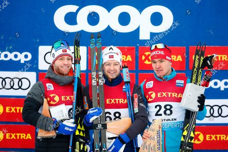 Norway's Sjur Roethe (C) smiles on the podium after winning the men's 30km Individual Free competition at the FIS Cross Country Skiing World Cup in Beitostolen, Norway, 08 December 2018. Roethe won ahead of his second placed compatriot Martin Johnsrud Sundby (L) and third placed Andrey Melnichenko (R) of Russia.