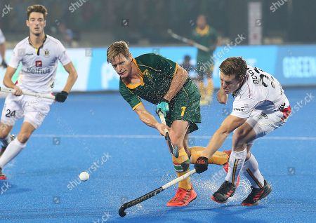 South Africa?s Tim Drummond (C) in action against Tom Boon of Belgium (R) during the men's Field Hockey World Cup match between Belgium and South Africa at the Kalinga Stadium in Bhubaneswar, India, 08 December 2018.