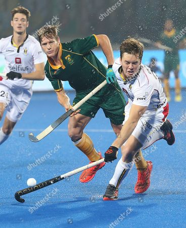 Stock Photo of South Africa?s Tim Drummond (C) in action against Tom Boon of Belgium (R) during the men's Field Hockey World Cup match between Belgium and South Africa at the Kalinga Stadium in Bhubaneswar, India, 08 December 2018.