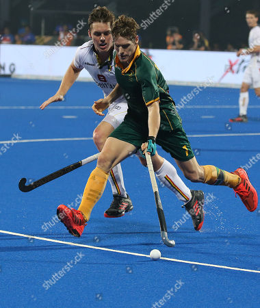 South Africa's Tim Drummond (R) in action against Tom Boon of Belgium during the men's Field Hockey World Cup match between Belgium and South Africa at the Kalinga Stadium in Bhubaneswar, India, 08 December 2018.