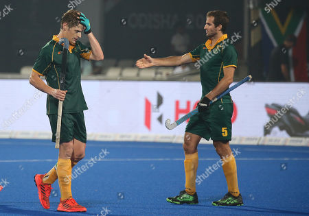 Stock Image of South Africa's Tim Drummond (L) and Austin Smith react after the men's Field Hockey World Cup match between Belgium and South Africa at the Kalinga Stadium in Bhubaneswar, India, 08 December 2018.