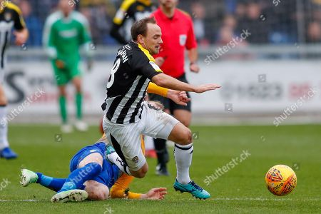 Notts County midfielder David Vaughan (8) is fouled during the EFL Sky Bet League 2 match between Mansfield Town and Notts County at the One Call Stadium, Mansfield