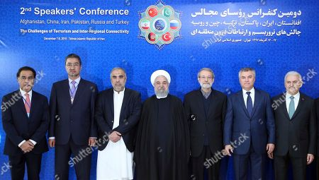 Hassan Rouhani, Binali Yildirim, Vyacheslav Volodin, Ali Larijani, Asad Qaiser, Abdul Rauf Ibrahimi. From right to left, Turkey's parliament speaker Binali Yildirim, Russian parliament speaker Vyacheslav Volodin, Iran's parliament speaker Ali Larijani, Iran's President Hassan Rouhani, speaker of the national assembly of Pakistan Asad Qaiser, and Afghan parliament speaker Abdul Rauf Ibrahimi, pose for photographs ahead of their meeting on fighting terrorism in Tehran, Iran, . President Hassan Rouhani on Saturday warned Western countries that they will face a massive influx of drugs if Iran becomes weakened by U.S. sanctions. The man on the left is unidentified