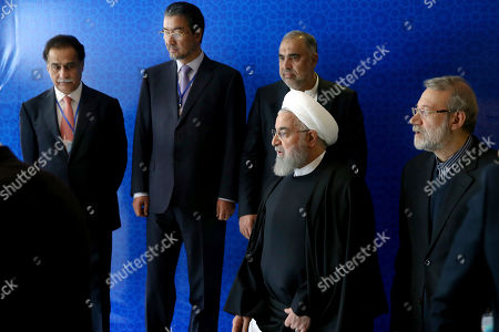 Hassan Rouhani, Ali Larijani. Iran's President Hassan Rouhani, center, attends a six-nation conference on fighting terrorism as he is accompanied by parliament speaker Ali Larijani, right, in Tehran, Iran, . Rouhani on Saturday warned Western countries that they will face a massive influx of drugs if Iran becomes weakened by U.S. sanctions. The man on the left is unidentified