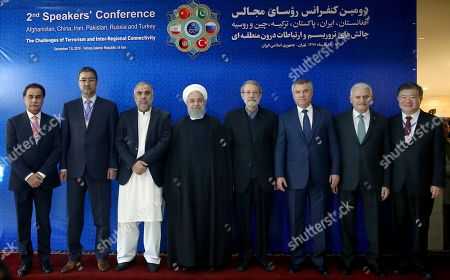 Hassan Rouhani, Chen Zhu, Binali Yildirim, Vyacheslav Volodin, Ali Larijani, Asad Qaiser, Abdul Rauf Ibrahimi. From right to left, deputy chairman of the National People's Congress of China, Chen Zhu, Turkey's parliament speaker Binali Yildirim, Russian parliament speaker Vyacheslav Volodin, Iran's parliament speaker Ali Larijani, Iran's President Hassan Rouhani, speaker of the national assembly of Pakistan Asad Qaiser, and Afghan parliament speaker Abdul Rauf Ibrahimi, pose for photographs ahead of their meeting on fighting terrorism in Tehran, Iran, . President Hassan Rouhani on Saturday warned Western countries that they will face a massive influx of drugs if Iran becomes weakened by U.S. sanctions. The man on the left is unidentified