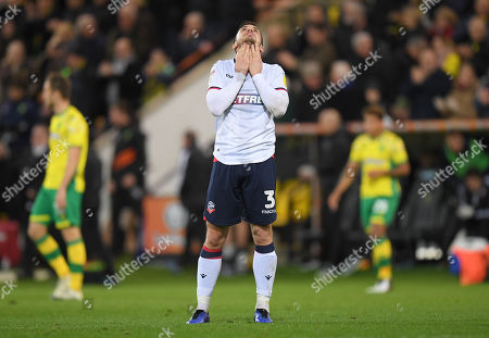 Andrew Taylor of Bolton Wanderers looks dejected at full-time