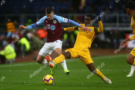 Brighton's Yves Bissouma tackles Johann Berg Gudmundsson of Burnley