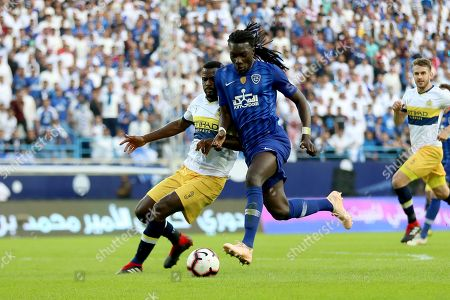 Stock Picture of Al-Nassr player Christian Ramos (L) in action for the ball with Al-Hilal player Bafetimbi Gomis (R) during the Saudi Professional League soccer match between Al-Hilal and Al-Nassr at King Saud University Stadium in Riyadh, Saudi Arabia, 08 December 2018.